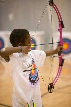 Student taking aim at a target.