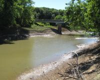 Bridge and dirt streambanks at Santa Fe Access