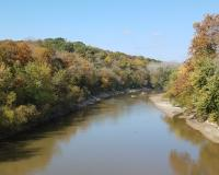 View of Upper Grand River showing autumn trees along both banks.