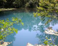 Photo of Alley Spring's pool of blue water.