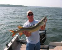 Fisheries biologist Mike Anderson shows muskie caught at lake pomme de terre