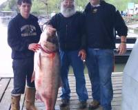 Photo of Gene Swope and grandsons with record bighead carp