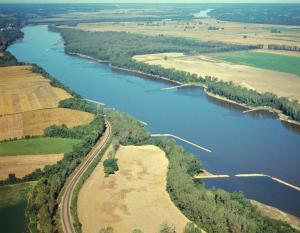 Aerial photo of the Missouri River showing wing dikes and nearby lands